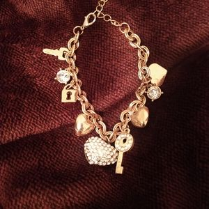 Gold charm lock and key braclet